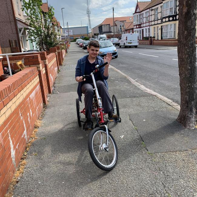 A TomCat trike could dramatically increase Kieran Ellison's mobility and ability to spend time with his family