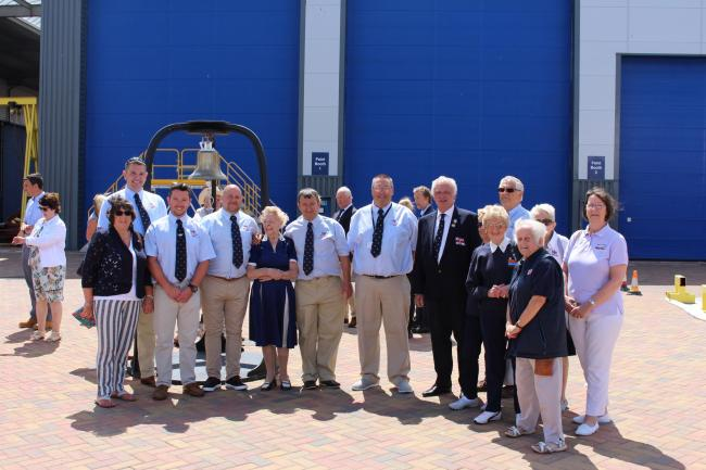 Rhyl RNLI crew, Mrs Webb, fifth from left, and supporters at the ceremony. Picture: RNLI/ Rhyl