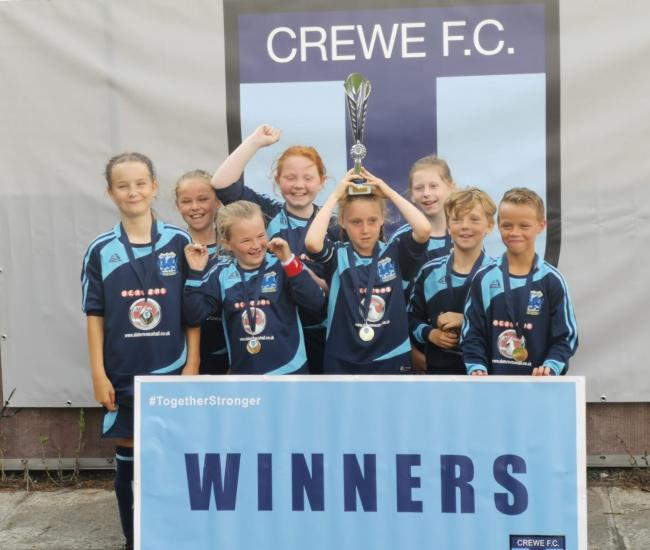 Kinmel Bay players celebrate winning the Crewe tournament