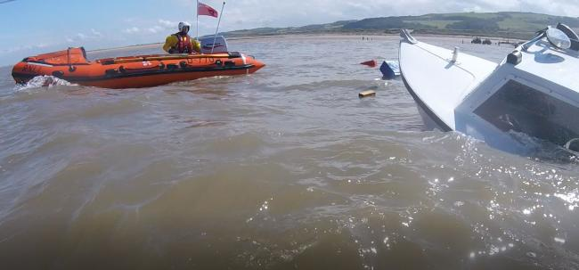 Rhyl inshore lifeboat and capsized boat. Picture: RNLI