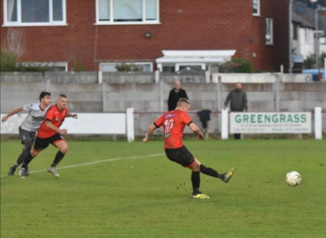 Rob Hughes nets Prestatyn Town's penalty against Guilsfield