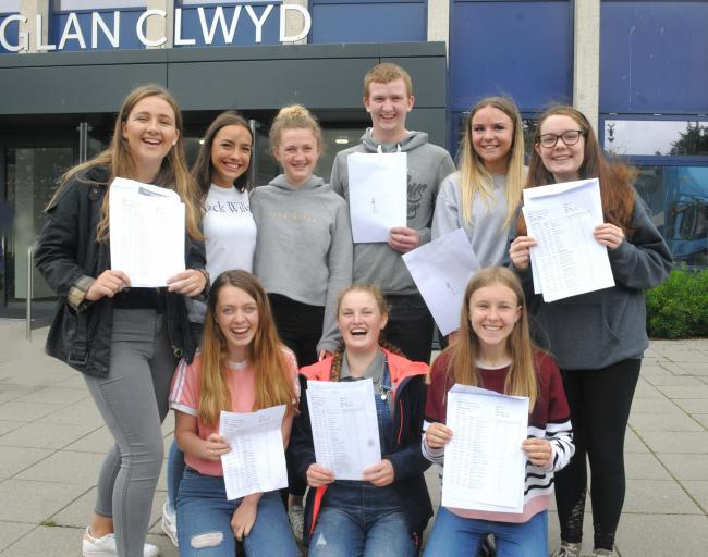 A group of happy students celebrate their GCSE passes at Ysgol Glan Clwyd. Picture: Phil Micheu