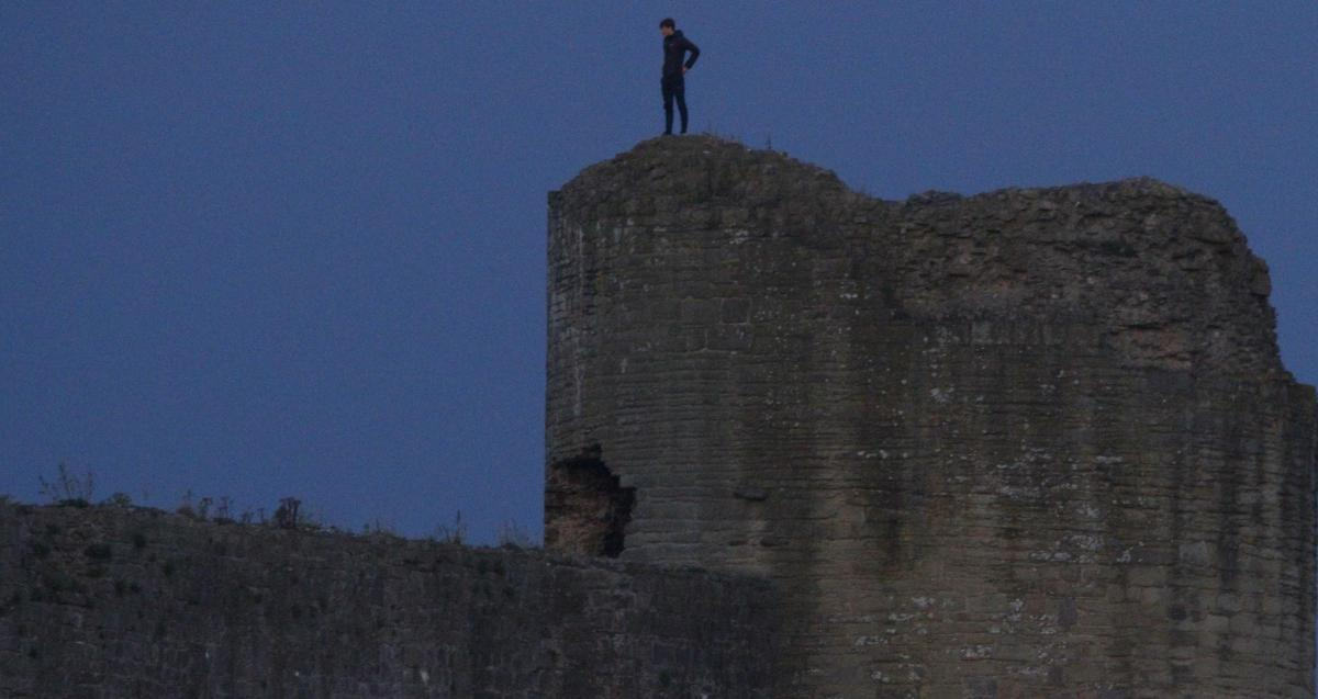 . Photographer notices youths balancing on top of walls and turrets at