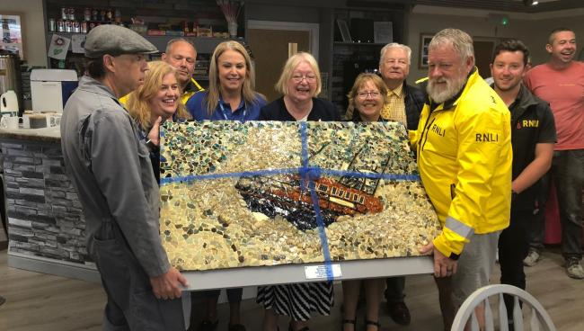 Rhyl Lifeboat crew receive a mural from ?Futures Rhyl? made from recycled glass collected from Rhyl beach community support. Picture Ann Jones AM/Twitter