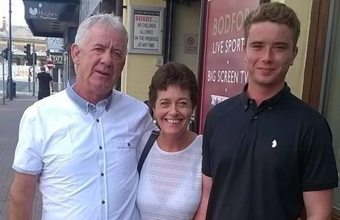Michael Lewis on the town in rhyl with his father Patrick Boland and mother Julie Lewis