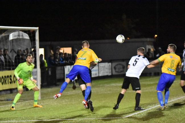 Kai Edwards opens the scoring for Prestatyn Town (Photo by John Pickles)