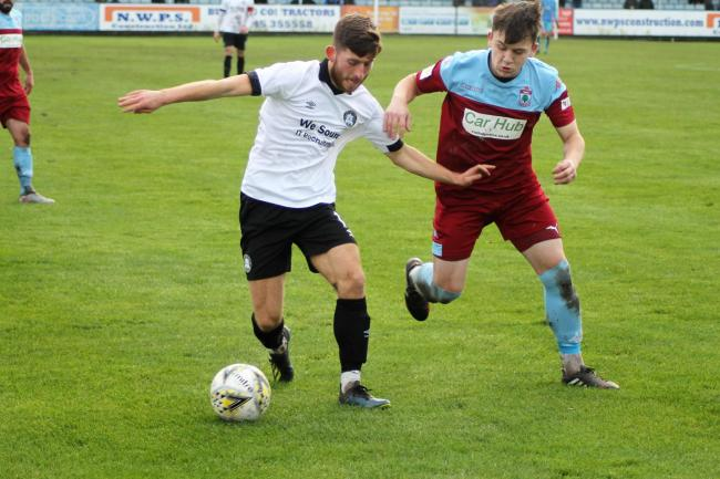 James Murphy in action for Rhyl against Colwyn Bay