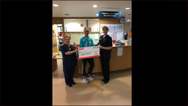 Vikki Jackson presents staff at Glan Clwyd Hospital with the cheque for £2,700