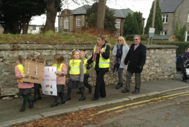 Pupils of St Asaph VP Infants school picket for a safer crossing