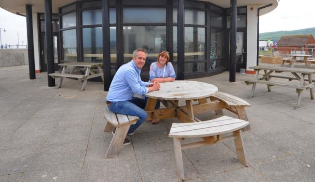 Cllr Martyn Poller with cllr Andrea Tomlin in 2018 at the beachside cafe before it re-opened under new ownership. Picture: Phil Micheu