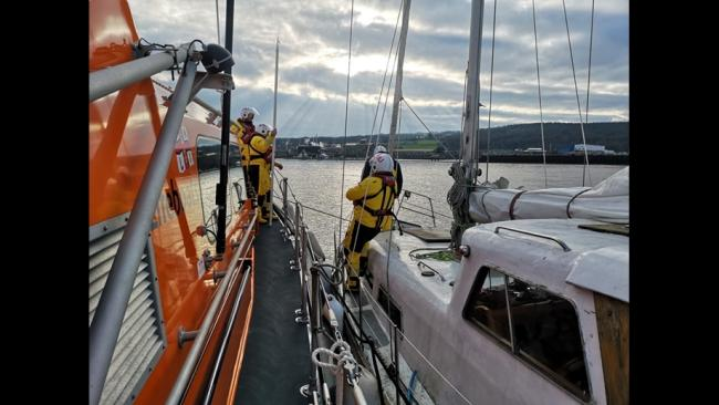'Miss Moneypenny ' being towed in to Mostyn Harbour by Rhyl lifeboat. Picture: RNLI/Callum Robinson