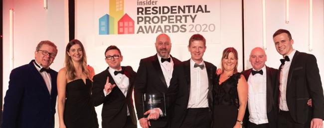 Staff from Anwyl Homes celebrate their Housebuilder of the Year award