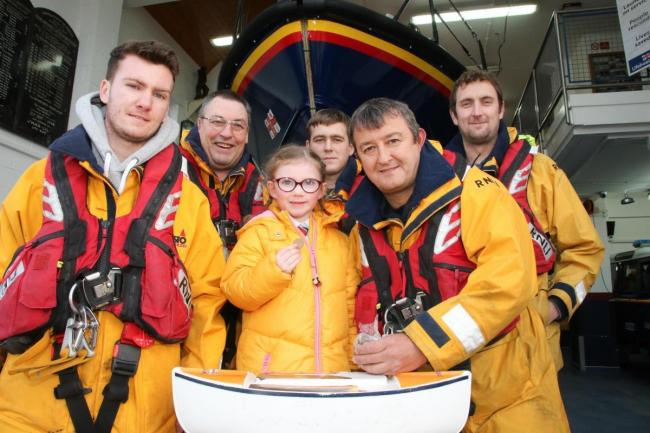 Darcey Payne with Rhyl lifeboat coxswain Martin Jones, right, and other crew KR290119d
