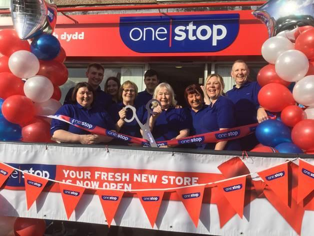 Staff cut the ribbon on the new look One Stop on Ffordd Ffynon