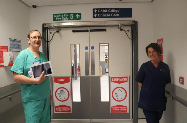 Consultant in Anaesthetics & Intensive Care Dr Brian Tehan with the donated iPads and Nurse Sharon Jones from Glan Clwyd Hospital's ICU.