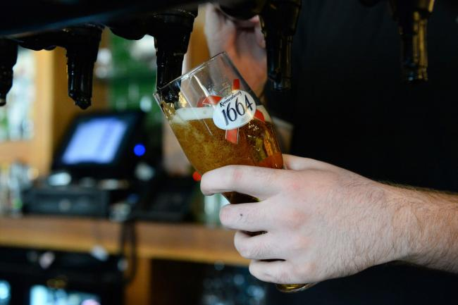 A bar tender pouring a beer in a pub. Image: PA