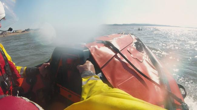 Two people surrounded by water as seen by the RNLI. Picture: Facebook/ RNLI Rhyl