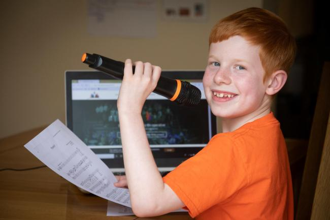 Henry Piggot, nine, who does online singing lessons. PICTURE: Mandy Jones