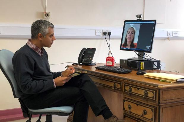 Dr Dilesh Thaker, Consultant Anaesthetist, and James Needham, Physiotherapist specialising in Pain Management, with the Attend Anywhere consultation software