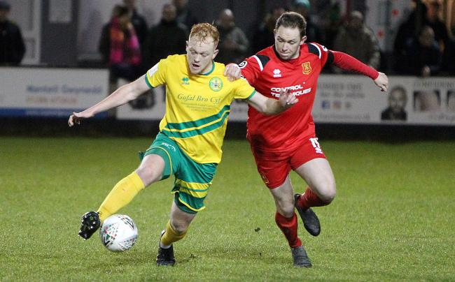 Sio Bradley set up Caernarfon Town's goal. (Photo by Richard Birch)