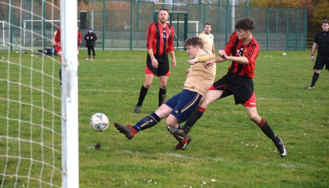 Action from Kinmel Bay's friendly against Penmaenmawr Phoenix Reserves. (Photo by Bary Griffiths)