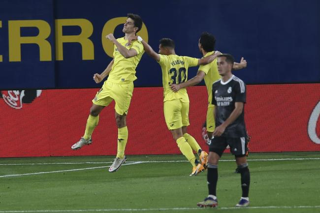 A late penalty from Gerard Moreno (left) helped Villarreal maintain their unbeaten home record