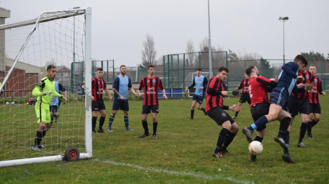 Action from Kinmel Bay's win over Llanfairfechan Town (Photo by Barry Griffiths)