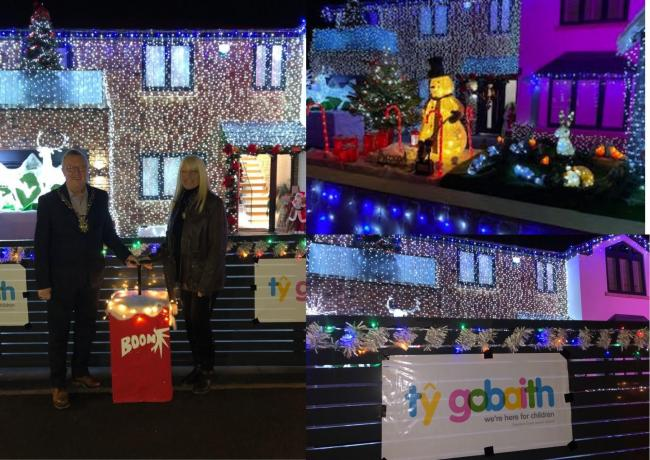 Cllr Alan Hunter and mayoress, Cheryl Hunter, and the house lit up in Abergele. Picture: Jeanette Jackson
