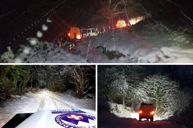 Two people had to be rescued from Moel Famau in severe weather conditions. Pics by NEWSAR.