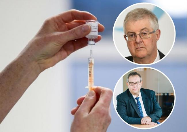 Wales' first minister Mark Drakeford and  Dr David Bailey, Chair of the BMA in Wales. Back picture (PA) of Covid vaccine
