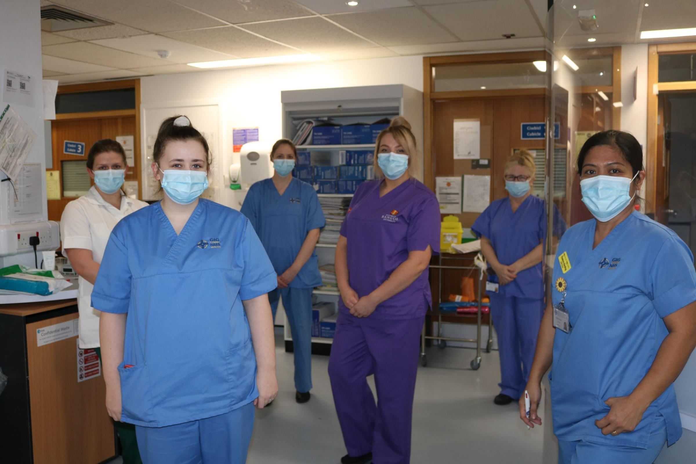 Abby (centre) with her colleagues on Aran Ward who have been caring for Covid patients throughout the pandemic.