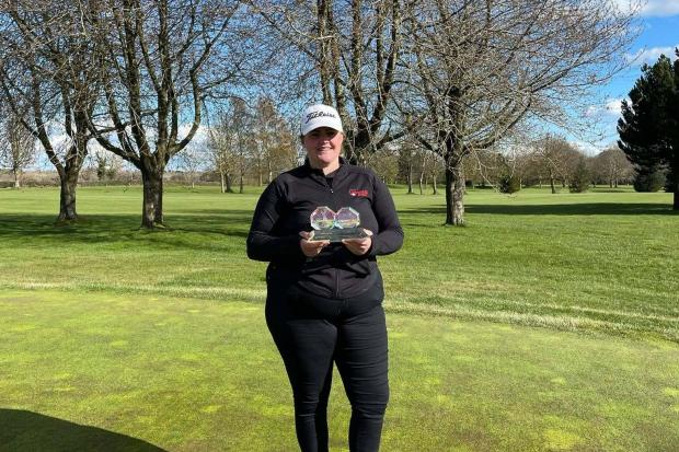 Lea-Anne Bramwell with the Denbighshire and Flintshire County Ladies Championship trophy in Padeswood.