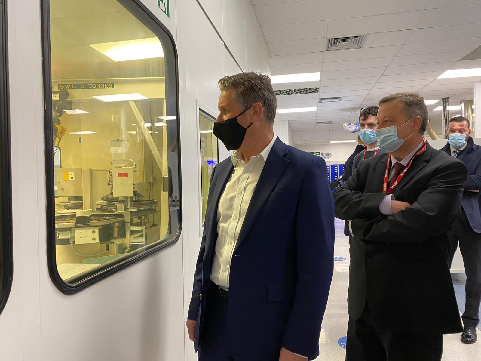Taking a closer look during a visit to the Qioptiq in Bodelwyddan. Pictures: Welsh Labour