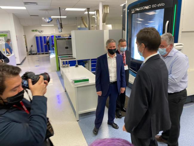 The Labour leader meets with staff. Pictures: Welsh Labour