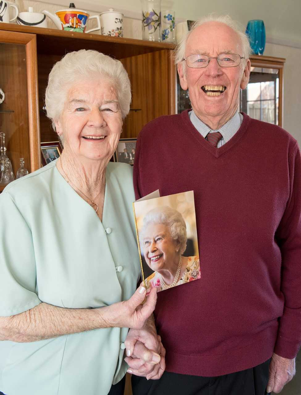 Clive and Morwena pictured with their Anniversary Card from The Queen. Picture: Chris Porteous Photography