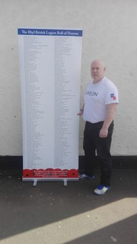 Richard Kendrick with the portable Rhyl Roll of Honour