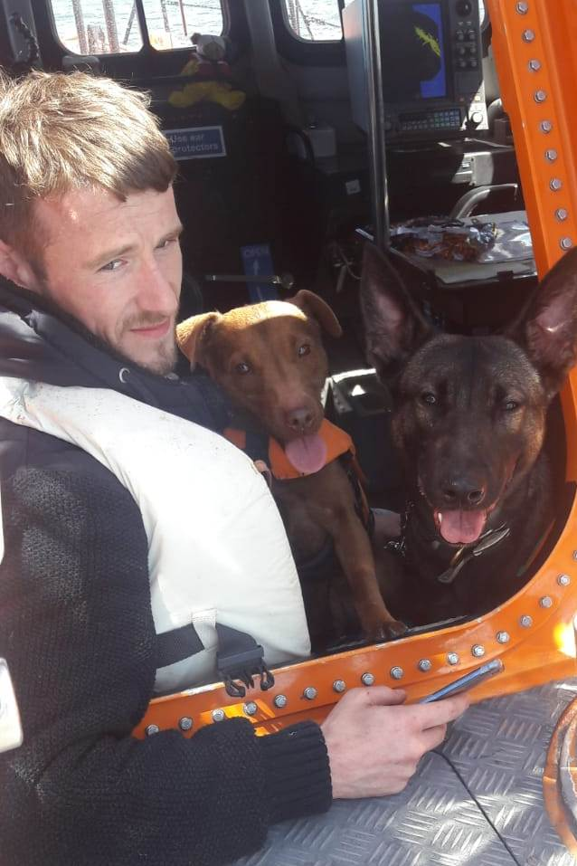 Two men and two dogs were rescued from a sinking speedboat. Picture: RNLI/Tara Elliot