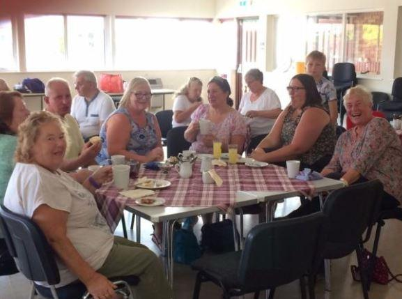 Customers of the community café at Salford Children's Holiday Camp