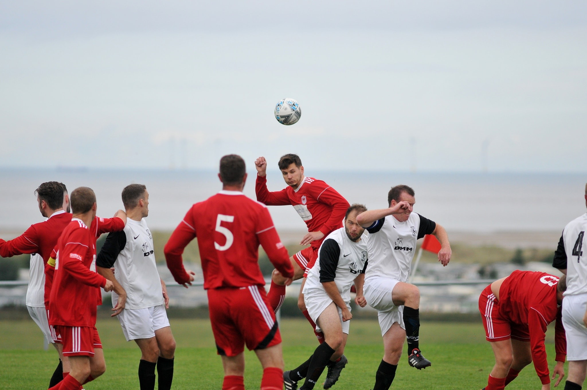 Action from Prestatyn Sports' win over Llanrug United (Photo: Damon Mead)