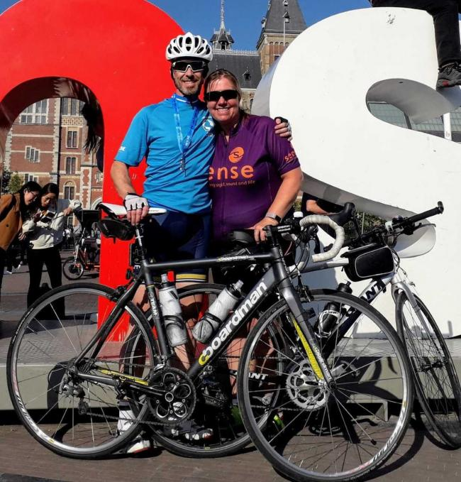 "Lee and Natalie Bailey arrive at the famous ""I Amsterdam"" sign"