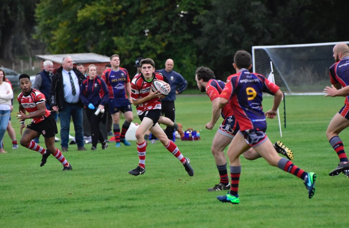Triple try scorer Tom Jones on another run to his man of the match performance. Photo by Paul Brookes.