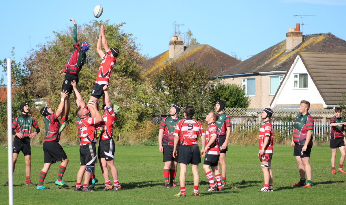 Rhyl youth lifted high to win the line out. Photo by Brian Hill.