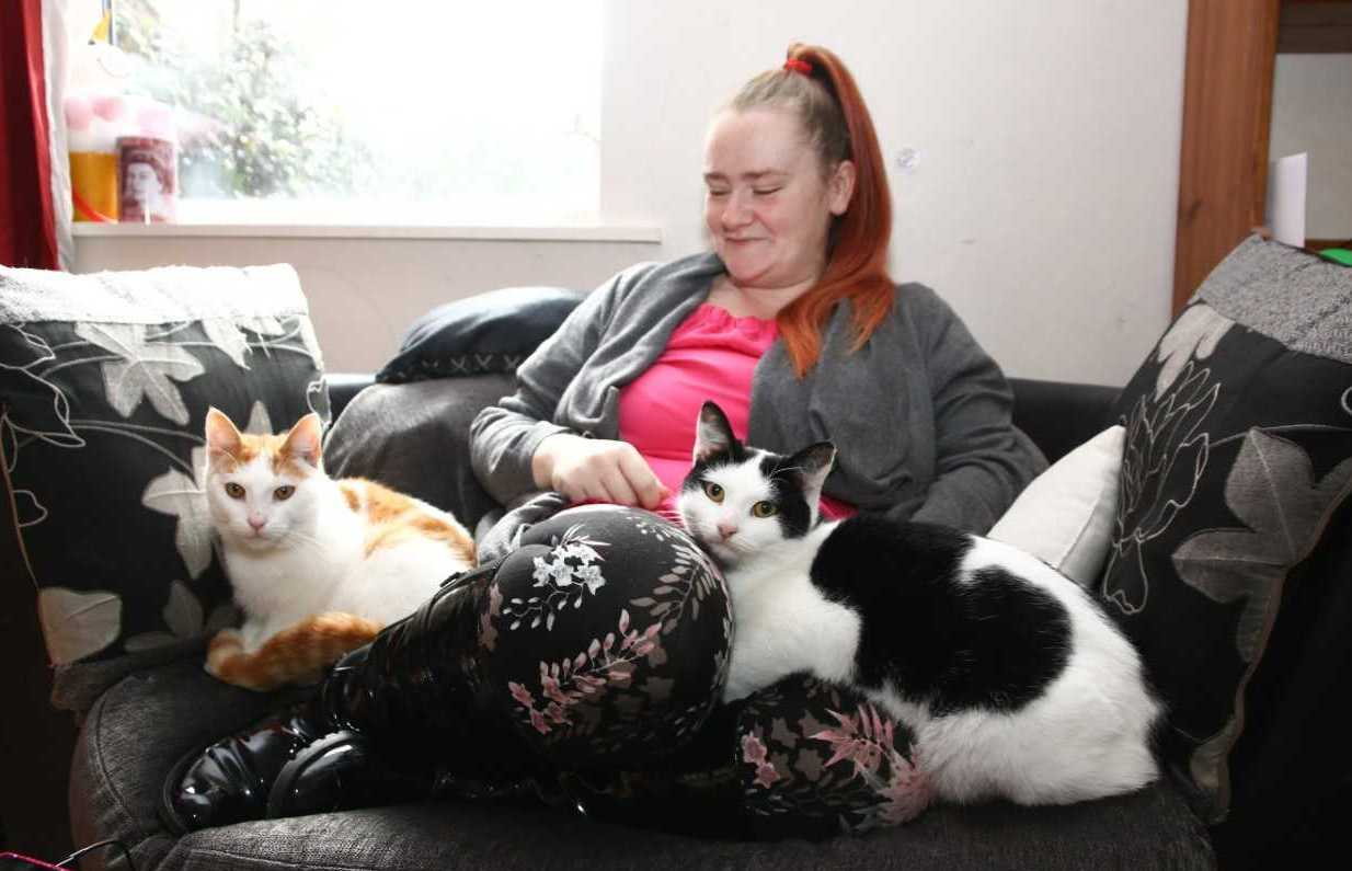 Vicki Gore-Harris, 31, of Rhyl with her cats. Picture: Kerry Roberts