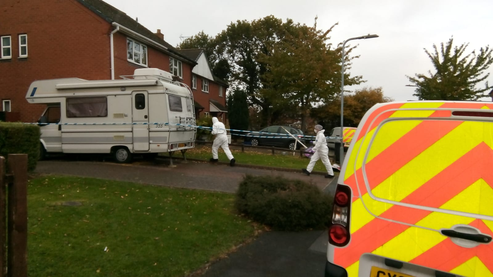 Forensic teams seen entering the home in Pen-y-Ffordd on Thursday morning
