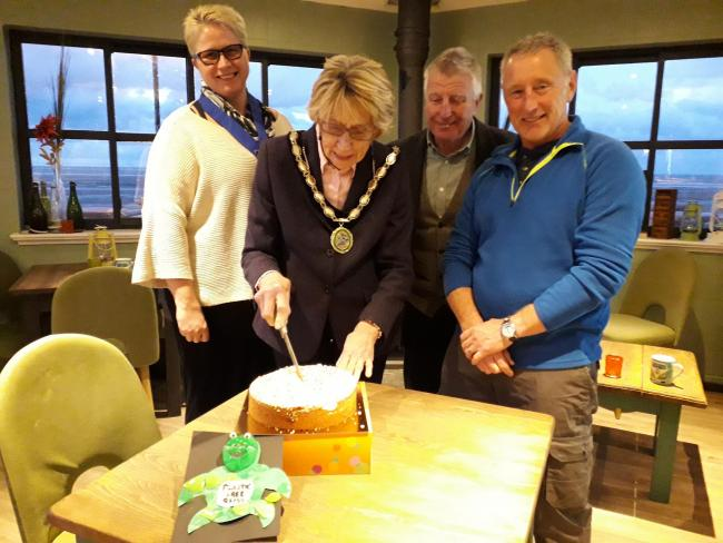 Mayor of Rhyl, cllr Win Mullen-James cutting the cake with Mayoress Catherine McNamara, cllr Alan James and cllr Keith Jones