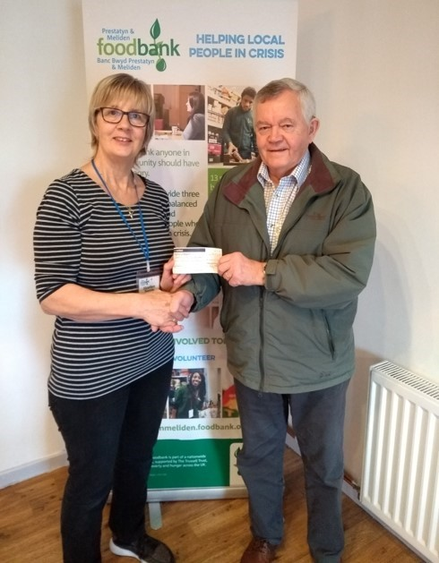 Mrs Heather Norris, manager of the foodbank and  Ron King  of St Melyd's Masonic Royal Arch Chapter