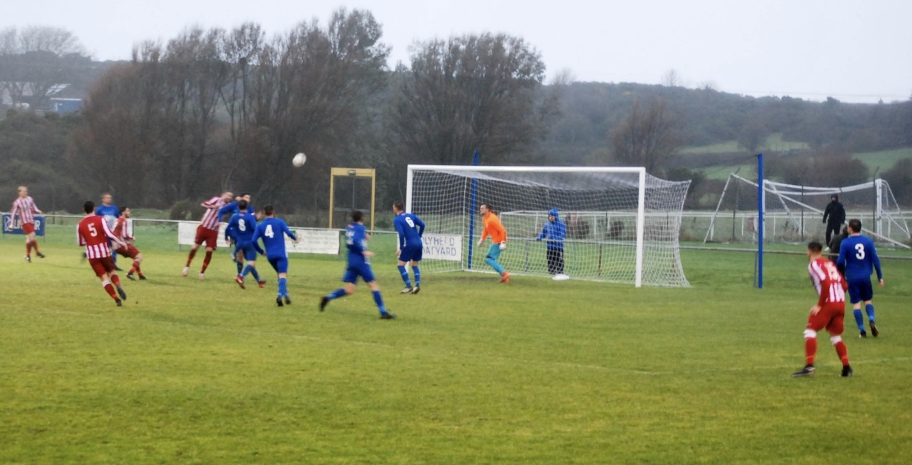Steve Lewis heads home Holywell Town's first against Holyhead Hotspur