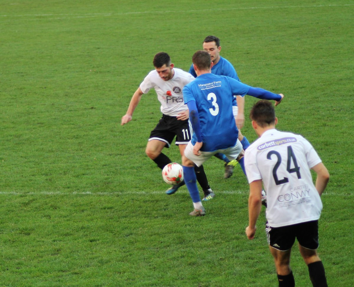 James Murphy in action for Rhyl against Caersws