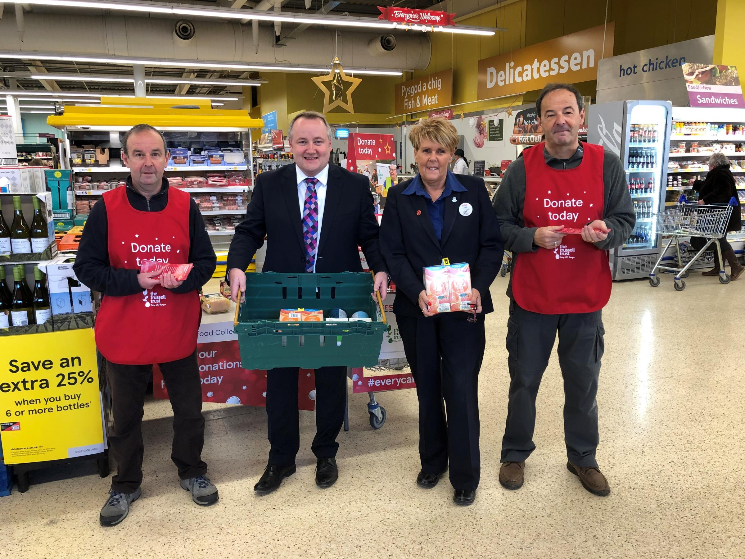 Clwyd West AM Darren Millar collecting food at Abergele Tesco with staff members Ian Evans, Doug Robinson and Jan Williams.