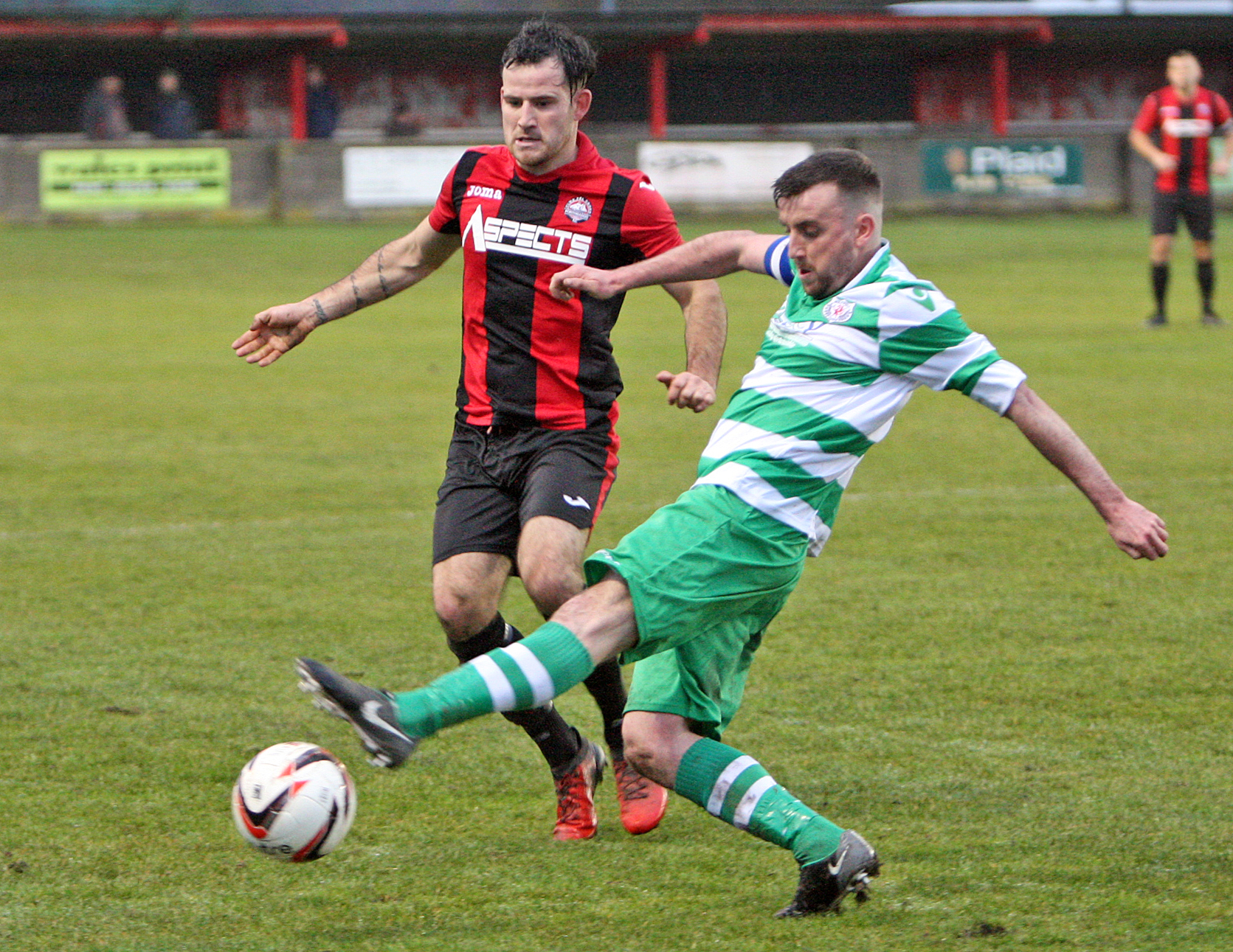 Jay Gibbs in action for Porthmadog against Holywell Town (Photo by Richard Birch)